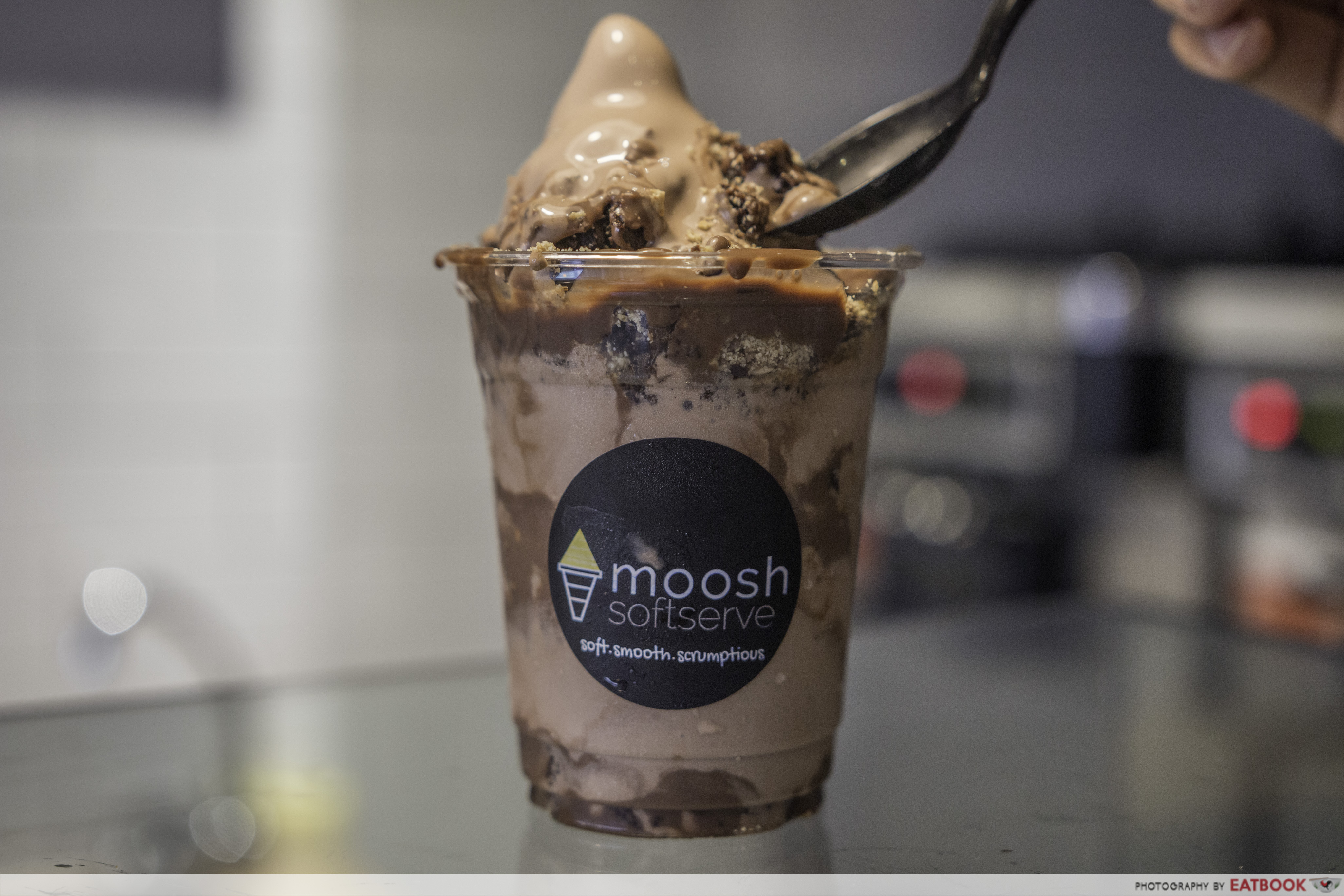 Moosh - Nutella Brownie Cheesecake Soft Serve scooping