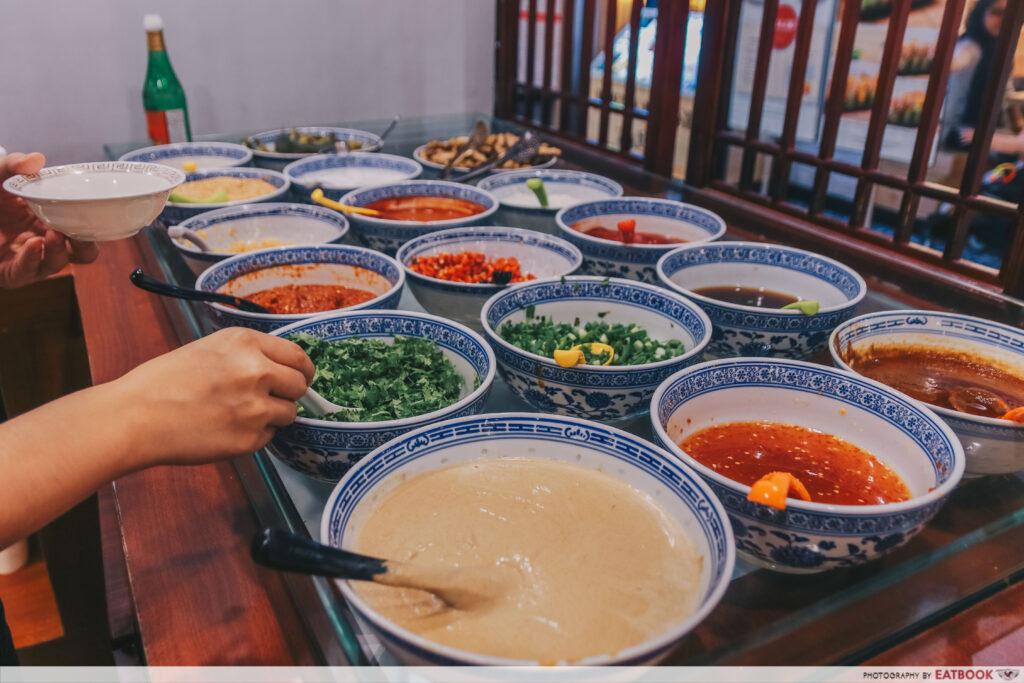 yi qian ling yi ye steamboat buffet - condiments bar