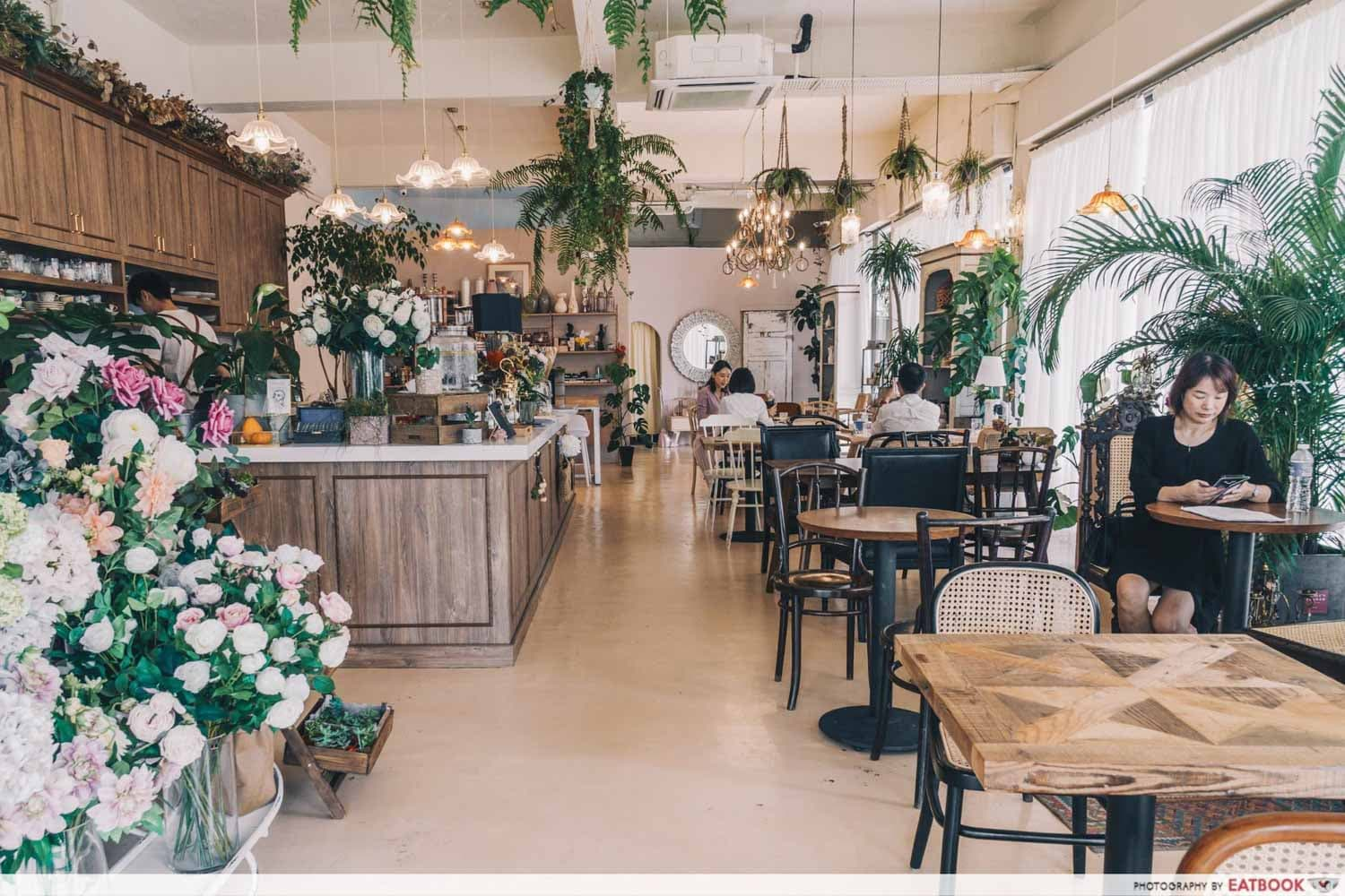 12 New Restaurants June - Cafe de Nicole's flower ambience