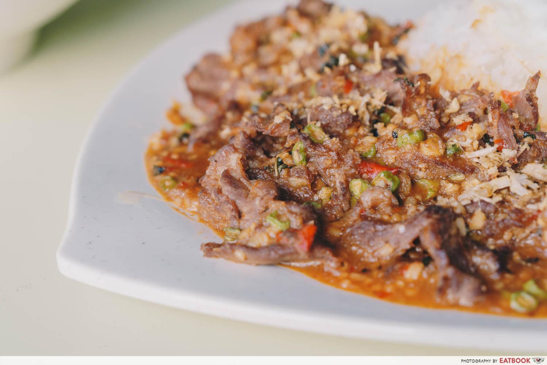 omar's halal thai beef noodles thai basil mutton closeup