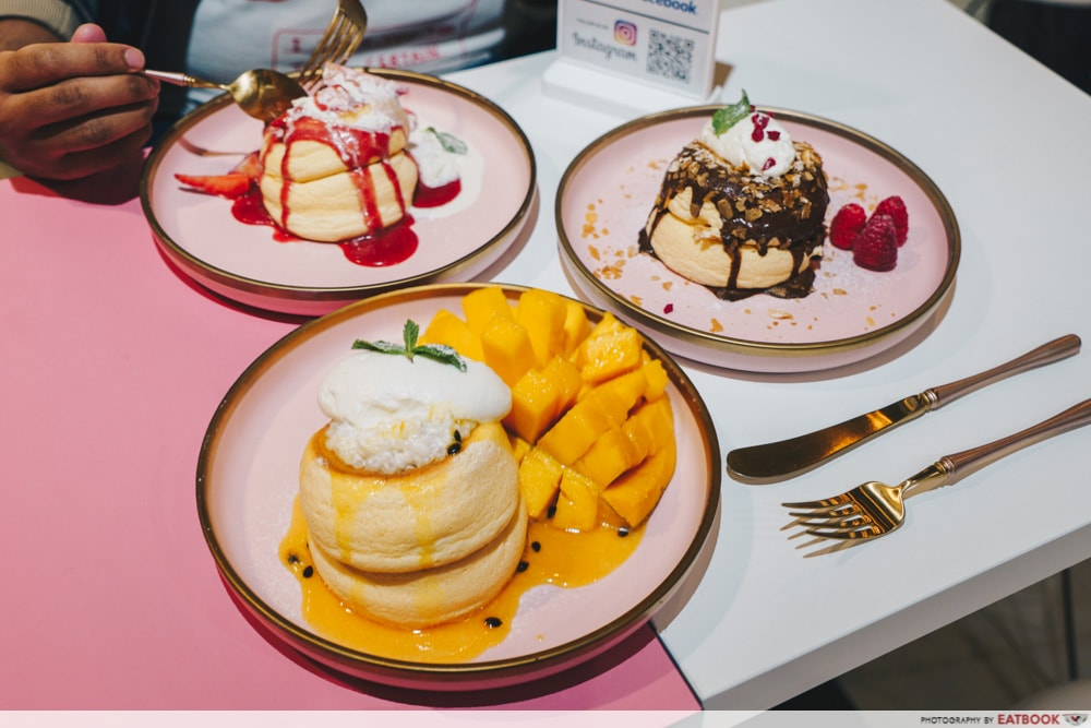 Three plates of souffle pancakes on a table