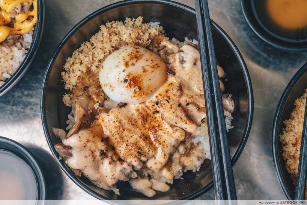 bowl of chicken with mentaiko sauce and jiggly egg
