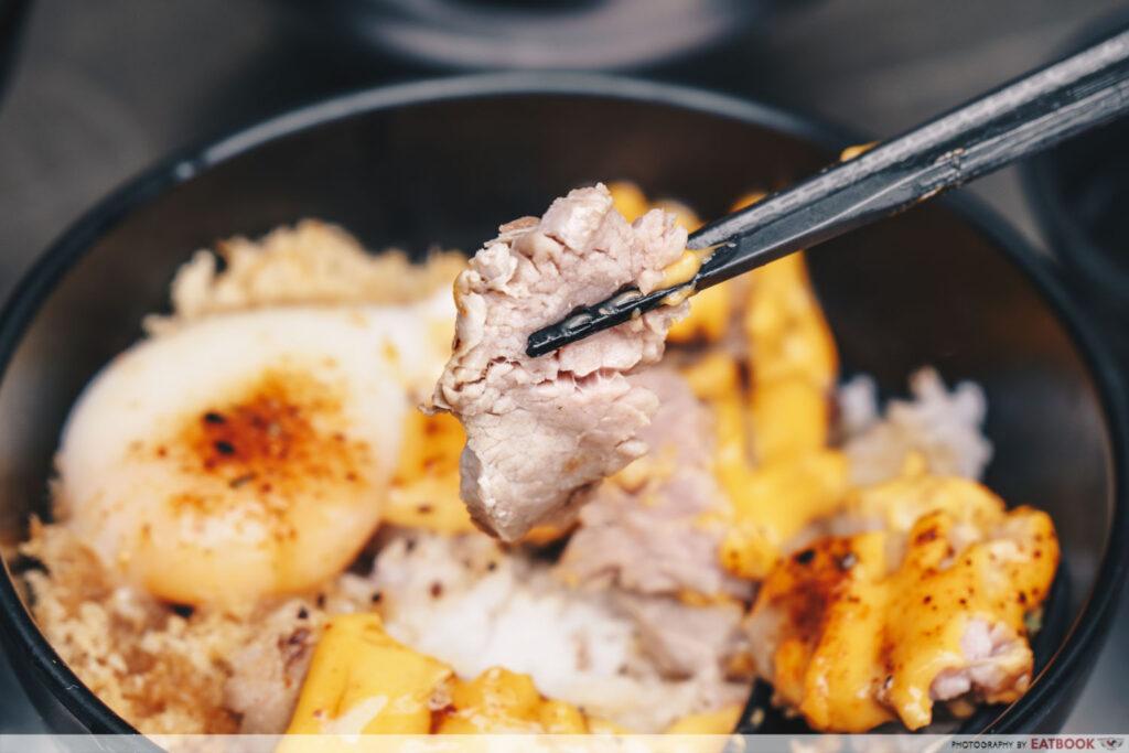 chopstick holding up roast beef