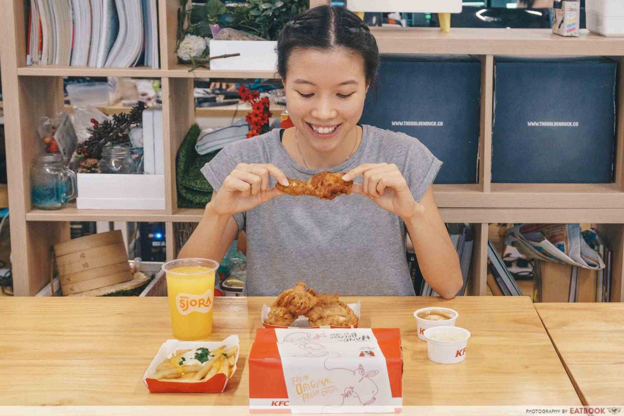 A girl eating KFC food
