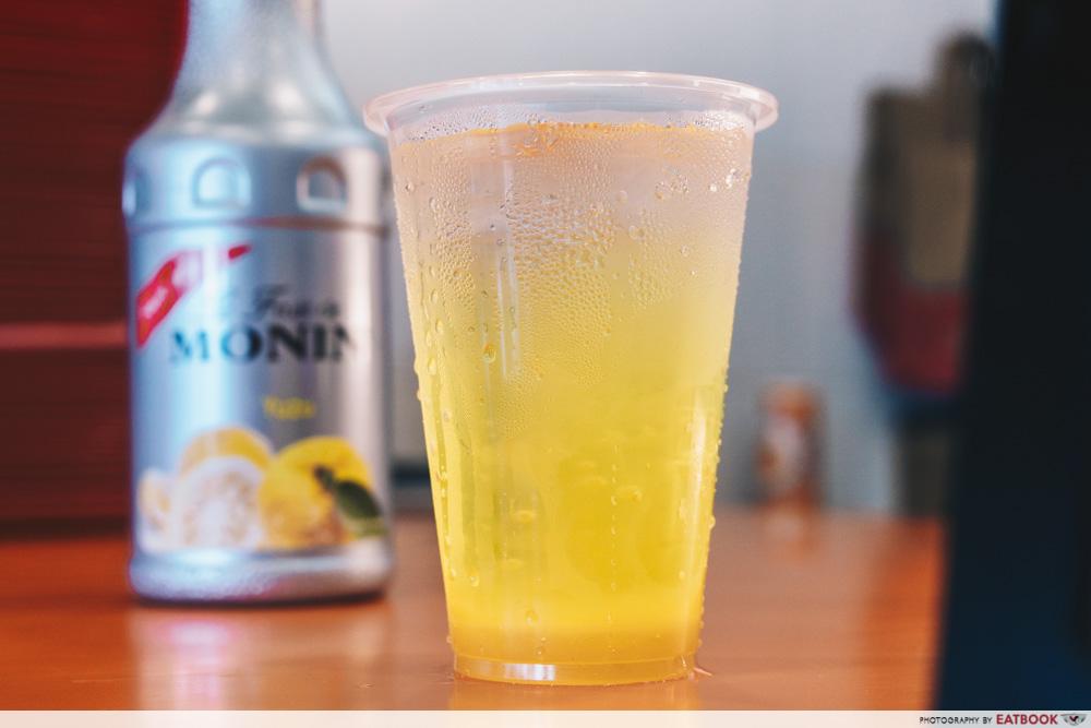 Yuzu mountain dew in a plastic cup