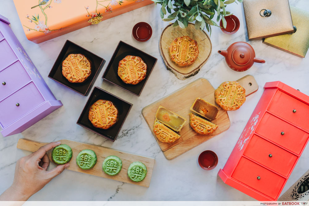 Flatlay of all the mooncakes with the boxes