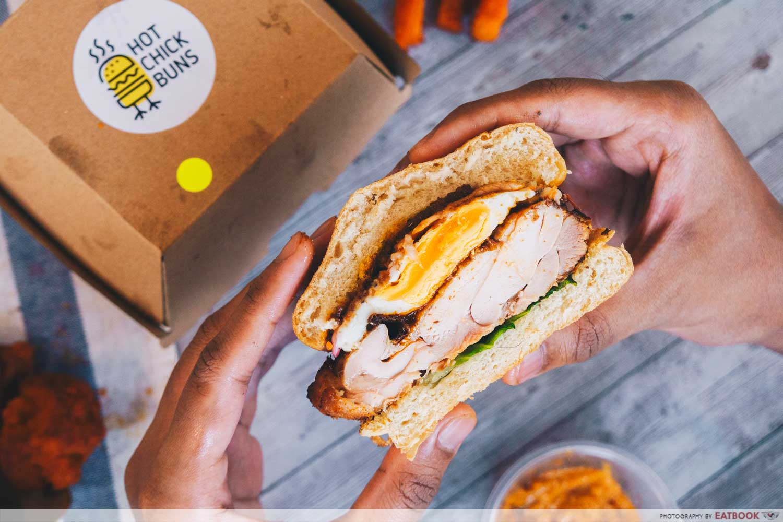 Burger with runny yolk and juicy chicken