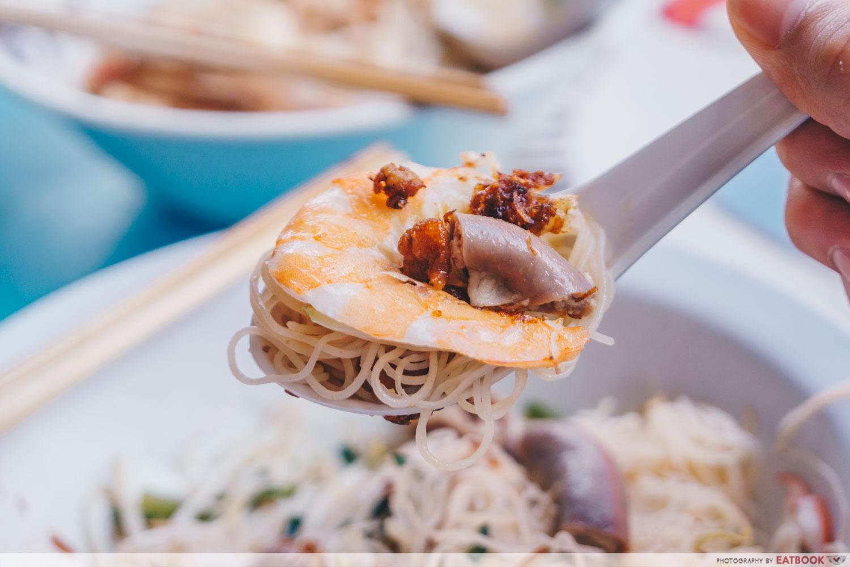 Da Dong Prawn Noodles - Spoonful of pork intestine prawn noodles