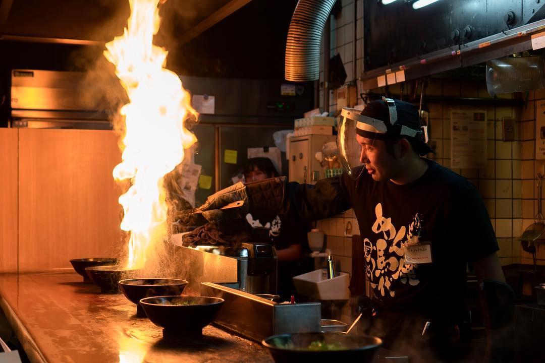 Menbaka Fire Ramen - Chef pouring oil on ramen