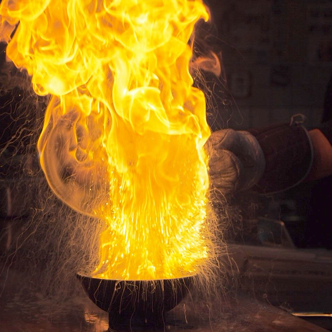 Menbaka Fire Ramen - Close-up shot of flaming ramen bowl