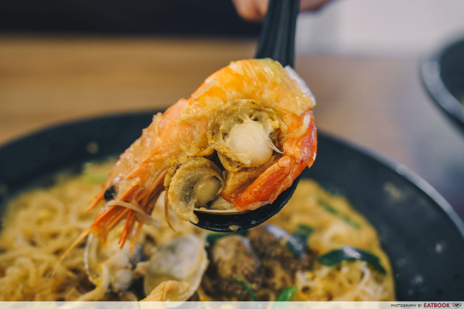 Try Fresh XO Seafood Noodles -Spoonful of seafood salted egg