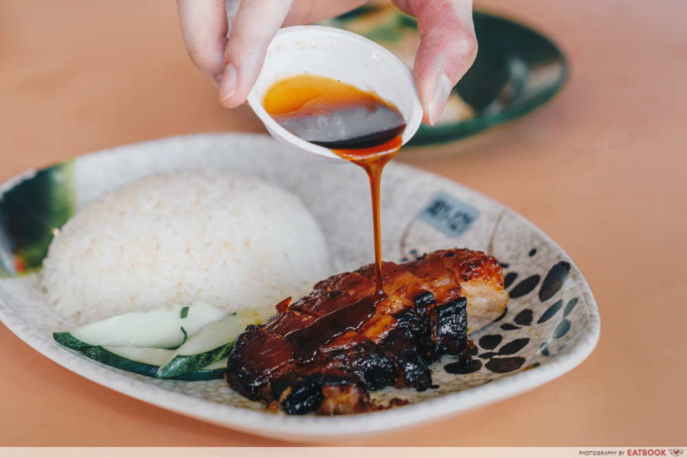 Drizzling char siew sauce
