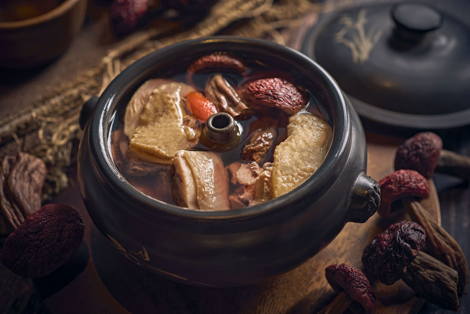 Yun Nans Nex - steamed pot chicken soup with red mushrooms