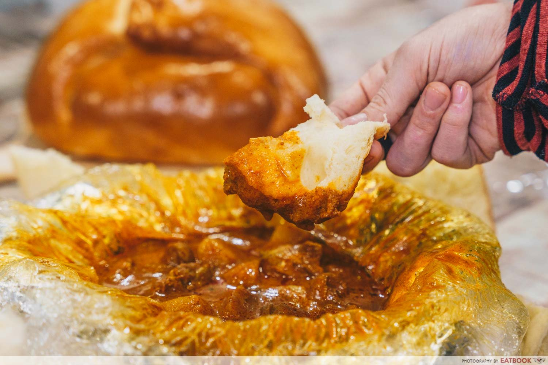 eat my cb curry bun open