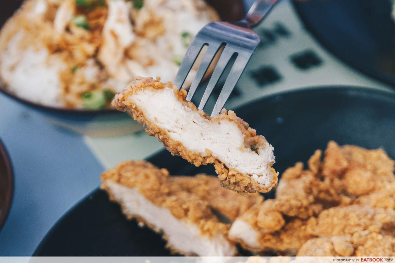 chicken cutlet on fork