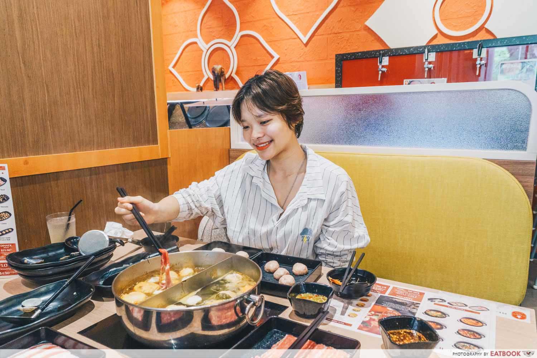 Suki Suki Thai Hot Pot - eating shot