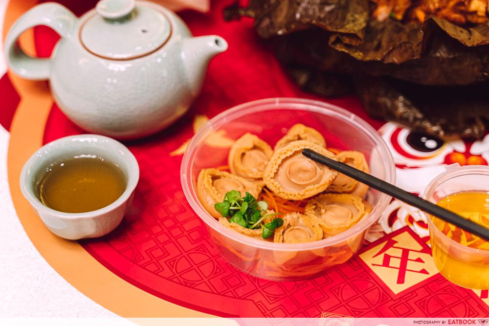 abalone yusheng picked up with chopsticks