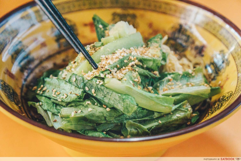 Da Shao Chong Qing Xiao Mian - mala noodle vegetable close up