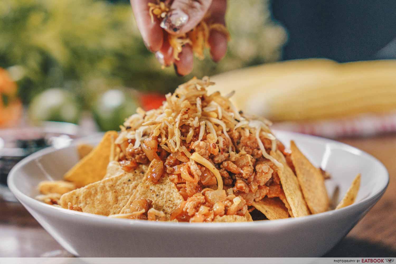 Old El Paso - sprinkling cheese on bulgogi nachos
