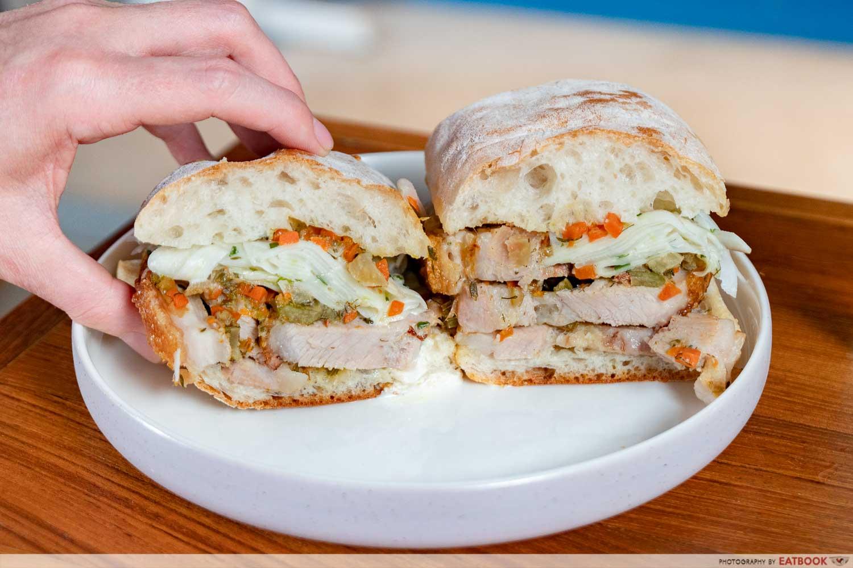 porchetta sandwich park bench deli
