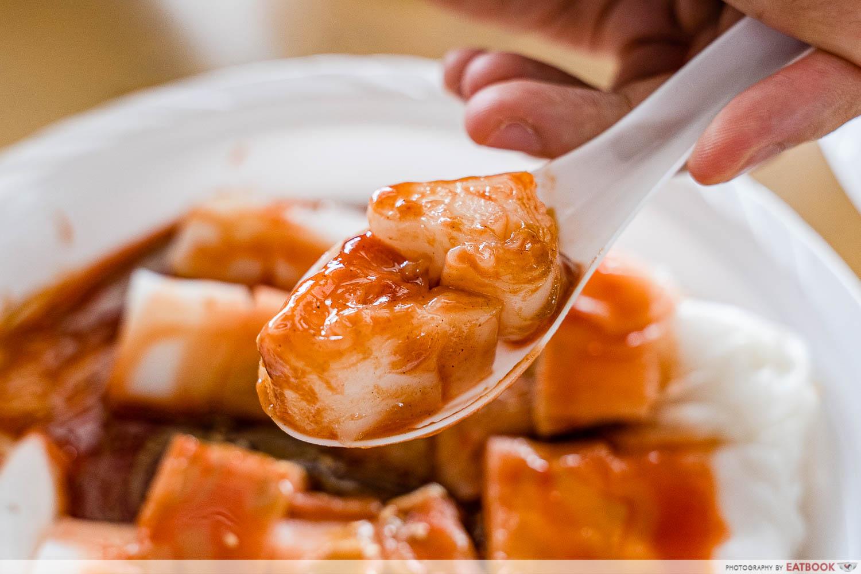 cheong fan paradise sesame sauce on spoon