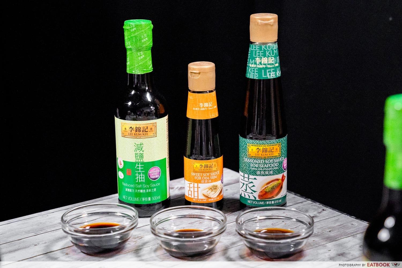 three bottles of lee kum kee sauces