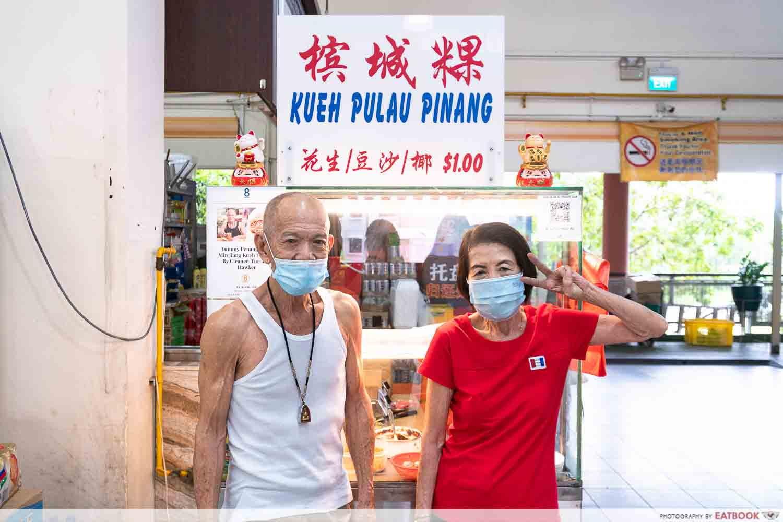 kueh pulau pinang storefront with owners
