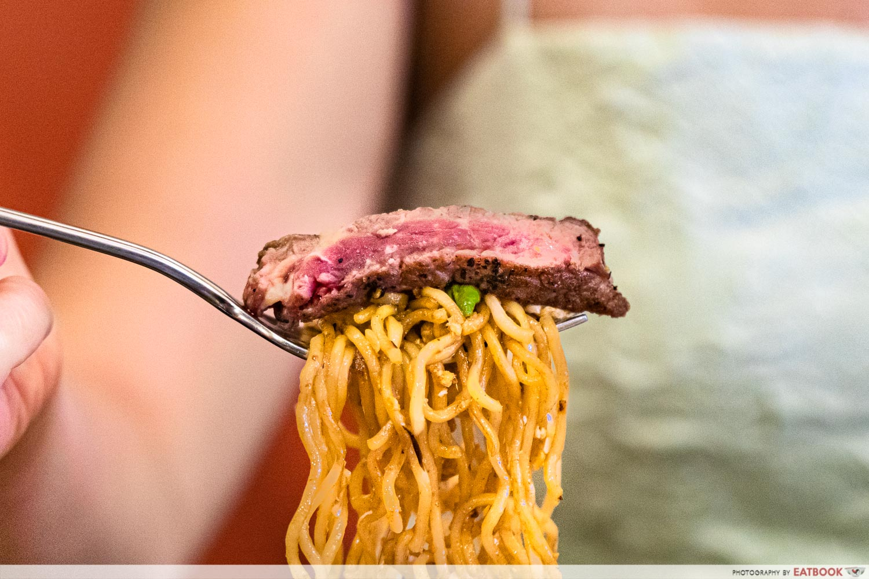 daun bistro - ribeye indomie on fork